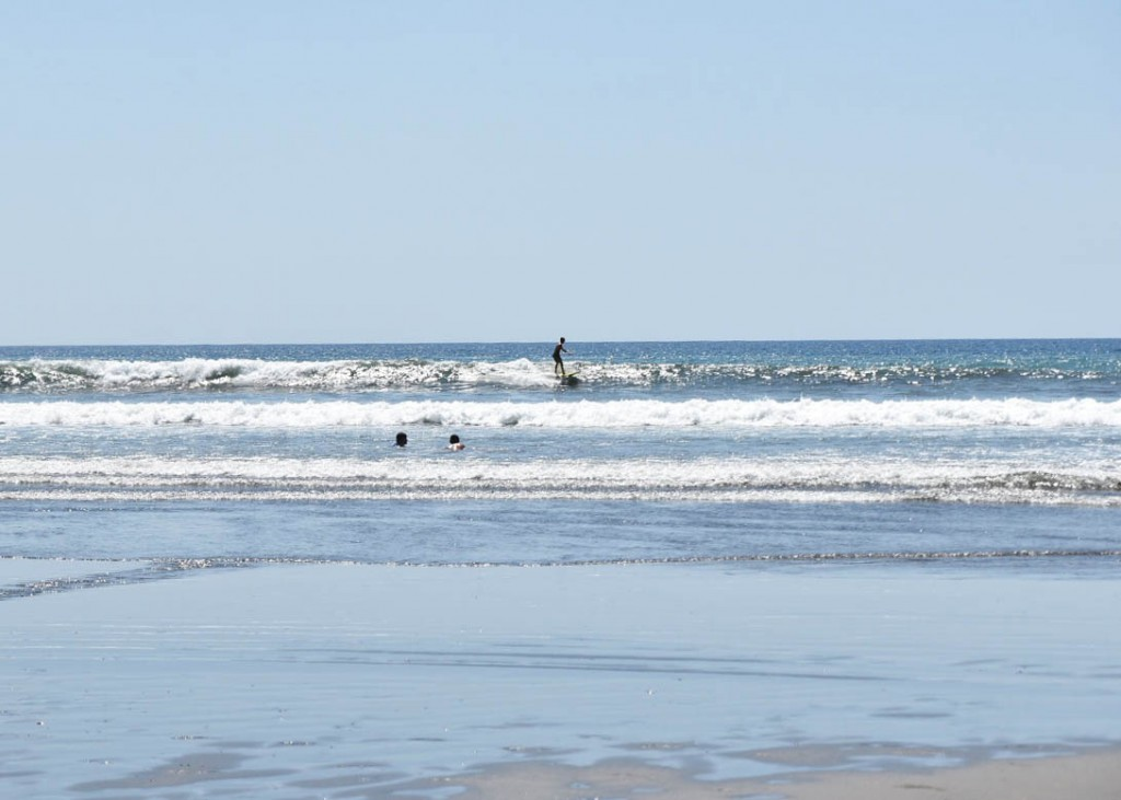 One surfer rides a small wave at the Room2Board left on less than ideal day.