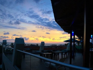 Sunset from the terrace at Room2Board Hostel & Surf School