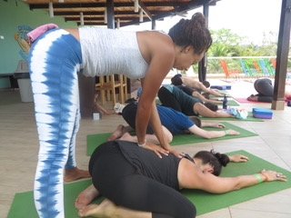 Louise K with hands on Yoga at Room2Board