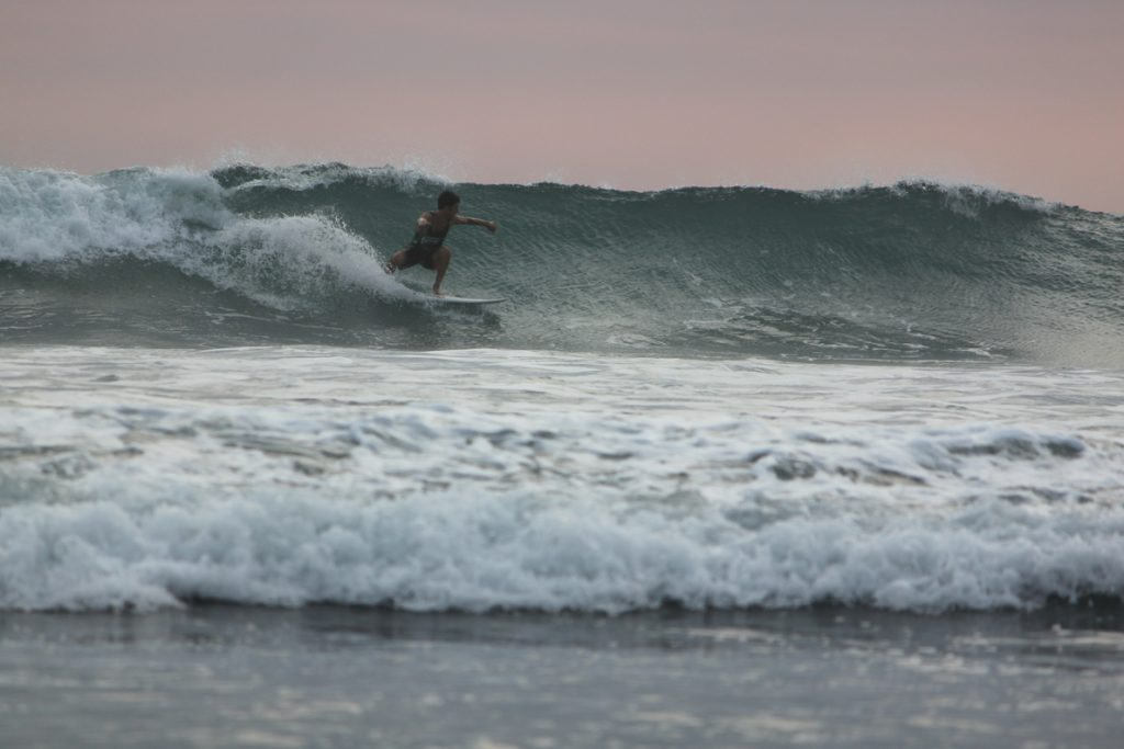Catching a sunset wave at Room2Board
